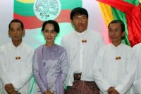 A file photo of Par Gyi (3rd left) while he was working as a bodyguard for Aung San Suu Kyi (2nd left). (Photo: DVB)