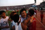 Zaw Zaw, the head of the Myanmar  Football Federation, celebrates with members of Burma's U-19 football team after their 1-0 victory against UAE yesterday.