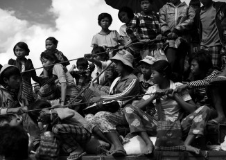 In this file photo from 2013, Kachin IDPs flee Namlim Pa. (PHOTO: Lee Yu Kyung/DVB)