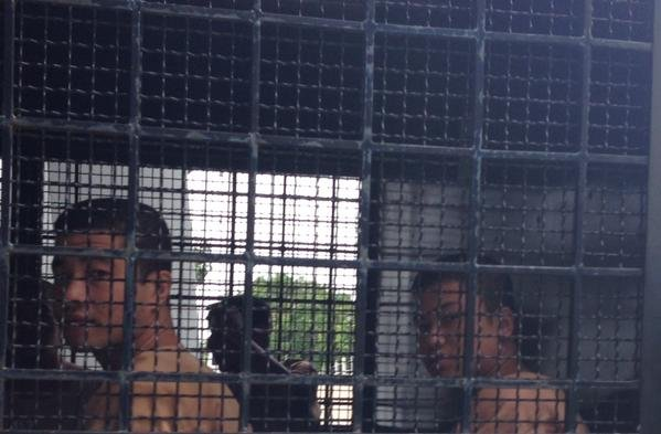 Murder suspects Win Zaw Htun (right) and Zaw Lin are taken to Koh Samui court house in a prison truck for a remand hearing on 20 November 2014. (PHOTO: Andy Hall)