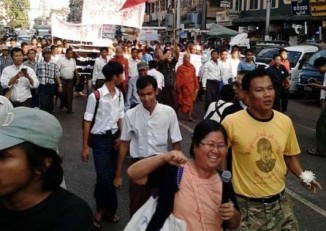 Naw Ohn Hla (foreground, pink) and Nay Myo Zin (yellow) lead protestors on a march to the Chinese embassy in Rangoon on 29 December 2014. (PHOTO: DVB)