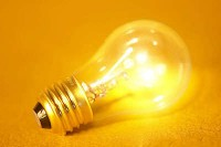 Light-bulb-on-a-yellow-background-uid-1180598