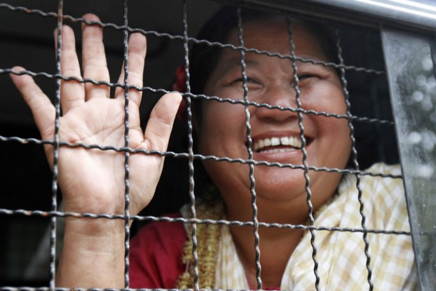 Naw Ohn Hla waves to supporters outside Dagon Township Court in Rangoon on 13 January 2015. (PHOTO: DVB)