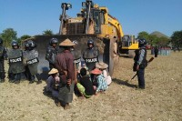 Latpadaung residents block a bulldozer to prevent erection of fencing around disputed plots of land. (PHOTO: DVB)