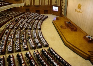Lawmakers takes their seats as parliament gavels in for a session on 2 May, 2015. (Photo: DVB)