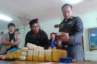 Thai police examine drugs and money found on two Burmese smugglers crossing the Moei River on 11 January 2015.  (Photo: DVB)