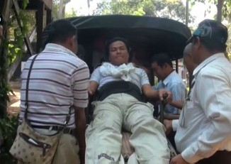 Nay Myo Zin is stretchered away from Dagon Township Court 24 February 2015