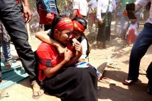 Two protestors comfort each other in the midst of the violence in Letpdadan on Tuesday (Photo: DVB)