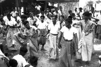 Revellers perform a traditional dance at Thingyan, or Burmese new year, in Sittwe in 1945 (Photo: WIkiCommons/ Glenn S. Hensley, the Hensley Photo Library)
