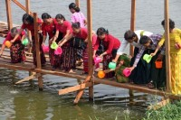 Members of the Democracy and Peace Women's Network release fish on the banks of Inya Lake (Photo: DVB).
