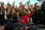 File photo from April 2015 shows Burmese army troops posing with weapons purportedly captured from Kokang rebels. (PHOTO: MOI)
