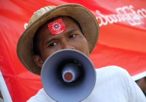 Workers from the Hlaing Thayar Industrial Zone, Rangoon, march from the Bo Seinman sports grounds in Bahan Township to the public protest grounds in Tamwe. The rally was organised by the Action Labour Rights group (Photo: DVB)