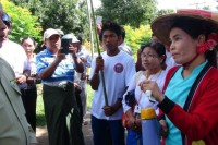 Su Su Nway, right, argues with a police official at a rally in Pyin Oo Lwin in June 2014. (Photo: Su Su Nway)