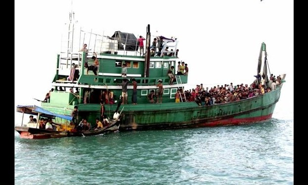 A boat carrying refugees from Burma and Bangladesh lies adrift in the Andaman Sea. (Reuters screenshot)
