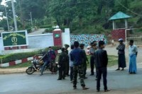 Officers stand at a checkpoint outside a military base in Taunggyi on 16 June 2015, shortly after a prisoner had escaped. (PHOTO: DVB).