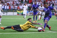 Burma's goalkeeper Aung Wai Phyo (in yellow) brings down striker Chan Vathanaka down for the penalty that resulted in Cambodia's second goal in a 3-3 draw. (PHOTO: Andrew Ho/SINGSOC)