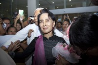 Aung San Suu Kyi, pictured at Rangoon airport on her return from China on 14 June 2015. (Photo: DVB)