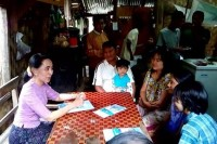 NLD leader Aung San Suu Kyi visits households in Kyitaungkan village in Pobbathiri Township, Naypyidaw, on 27 June 2015 to talk to residents about the importance of checking voter lists. (PHOTO: DVB)