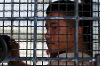 A File photo of Burmese migrant worker Win Zaw Htun as he is transported in a prison truck to Koh Samui Provincial Court. (Photo: Reuters)