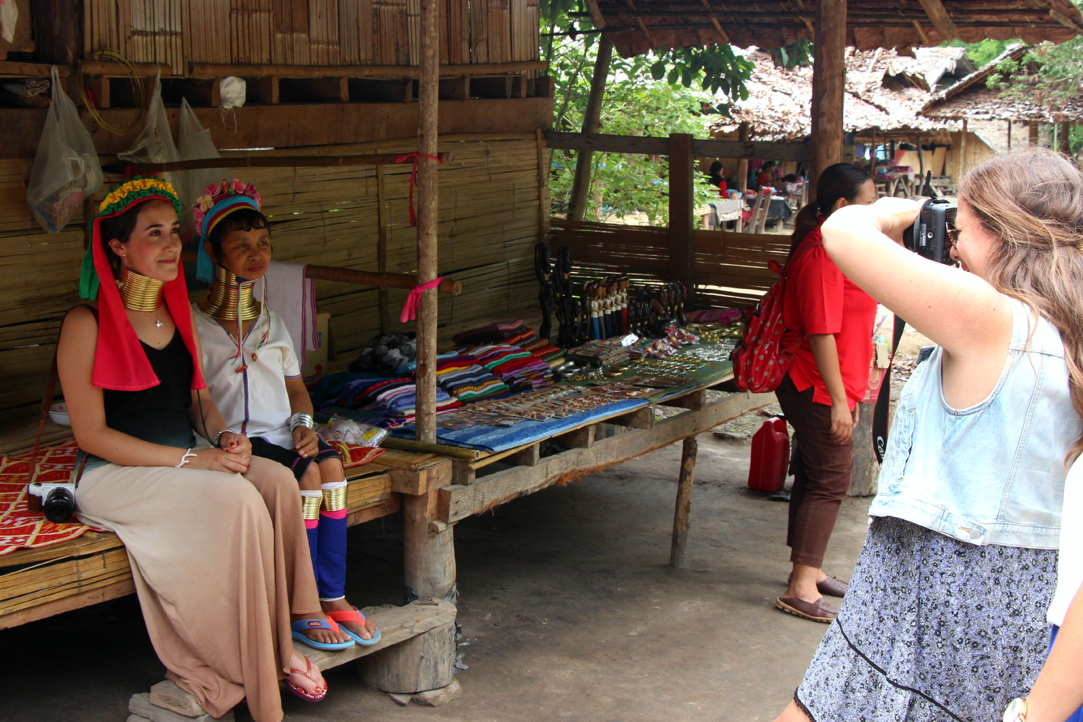 Visitors to the Baan Tong Luang village near Chiang Mai can try on 'tourist rings' and take a picture. (PHOTO: Melanie Keyte).