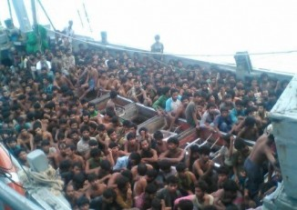 The boat holding hundreds of migrants detained by the Burmese navy in Irrawaddy Division on Friday morning (Photo: Ministry of Information).