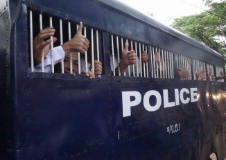 File photo of activists being escorted to Tharrawaddy courthouse for a prior hearing. (PHOTO: DVB)