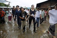 UNHCR special envoy Angelina Jolie Pitt and her son Maddox visit Jam Mai Kaung IDP camp in  Myitkyina on 30 July 2015. (PHOTO: Reuters)