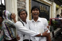 Kyaw Zaw Hein, a.k.a. Min Wathan, is hugged by his father upon his release from Insein prison in Rangoon on 30 July 2015. (PHOTO: DVB)