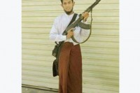The 2013 picture of Zaw Zaw Latt holding an assault rifle, which he posted on Facebook.
