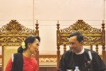 Burma's opposition leader Aung San Suu Kyi (left) chats with Lower House Speaker Shwe Mann of the ruling USDP in parliament. (PHOTO: Democracy for Burma)