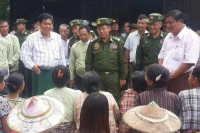 Hinthada MP Htay Oo (centre, white shirt) and Commander-in-Chief Snr-Gen Min Aung Hlaing (centre, military uniform) brief residents in Hinthada on 6 August 2015 before handing out relief supplies. (PHOTO: DVB)