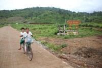 A school girl and friend ride on a bicycle in the village of Ngwe Pyaw in Myitkyina in Kachin State on 7 August 2015. (Photo: Hkun Lat/ Myanmar Now)