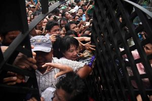 Hundreds of people jostle each other to enter a house compound in Thingangyun Township in Rangoon where a spirit event was taking place. (PHOTO: Thet Htoo / Myanmar Now)