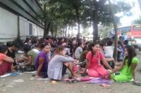Han Jen workers remain on strike outside a garment factory in Rangoon. (PHOTO: DVB)
