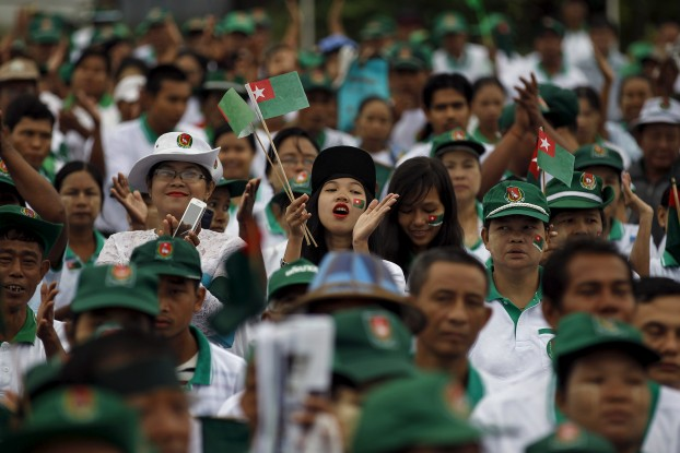 Supporters react during a Union Solidarity and Development Party (USDP) campaign rally in Rangoon, Burma October 10, 2015.