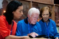 Field Office Director Sanne van den Bergh, former US president Jimmy Carter and his wife Rosalynn enter their findings into a tablet at a Cairo polling station on 24 May 2012.  (PHOTO: Carter Center)