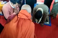In a photo on Wirathu's Facebook, Tin Oo kneels in a show of respect for monks.