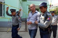 New Zealander Phil Blackwood is led to court in Rangoon on 17 February 2015 for his sixth hearing on charges of insulting Buddhism. (PHOTO: DVB)