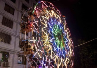 The neon coloured ferris wheel was a main attraction for many. (PHOTO: DVB)