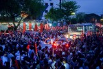 NLD supporters line the streets in celebration on Sunday evening. (PHOTO:DVB)
