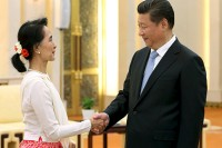 Aung San Suu Kyi shakes hands with Chinese President Xi Jinping during their meeting at the Great Hall of the People in Beijing, China, on 11 June 2015. (PHOTO: China Daily)