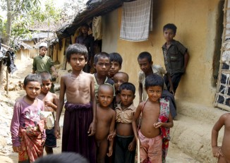 Rohingya children pose for the camera at the Kutupalong refugee camp in Bangladesh. (PHOTO: REUTERS/Rafiqur Rahman)