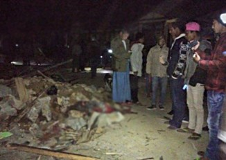 Locals and authorities inspect the scene of the explosion. (PHOTO: DVB)