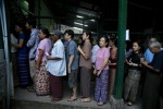 People line up to cast their votes at a polling station in Rangoon on 8 November 2015. (PHOTO: Reuters)