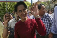 Aung San Suu Kyi waves at supporters as she visits a polling station at her constituency of Kawhmu on 8 November 2015. (Photo: Reuters)
