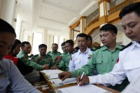 Military MPs sign in to a session of parliament in Naypyidaw, 16 November 2015. (PHOTO:DVB)