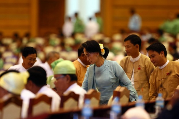 Aung San Suu Kyi takes a seat ahead of a sitting of Union Parliament in Naypyidaw, 24 November 2015. (PHOTO:DVB)