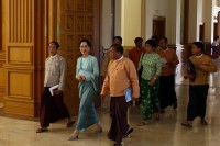 Aung San Suu Kyi enters the chamber ahead of a sitting of Union Parliament in Naypyidaw, 24 November 2015. (PHOTO:DVB)
