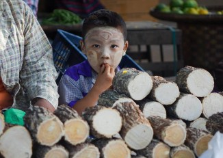 A young boy shows off his face thick with thanaka at a market in Magwe Division, Central Burma. PHOTO:DVB