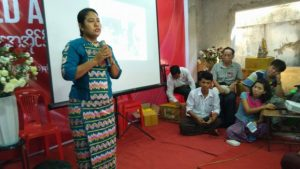 Phyu Phyu Thin speaks at the International AIDS Day event in the NLD headquarters in Bahan Township. (PHOTO: DVB)